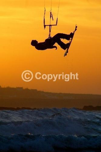 Kitesurfing images,kitesurfer Mike Smith,Kiteboarding Rhosneigr Angelsey,British Champion Mike Smith,kitesurf trick,Fluid Edge
