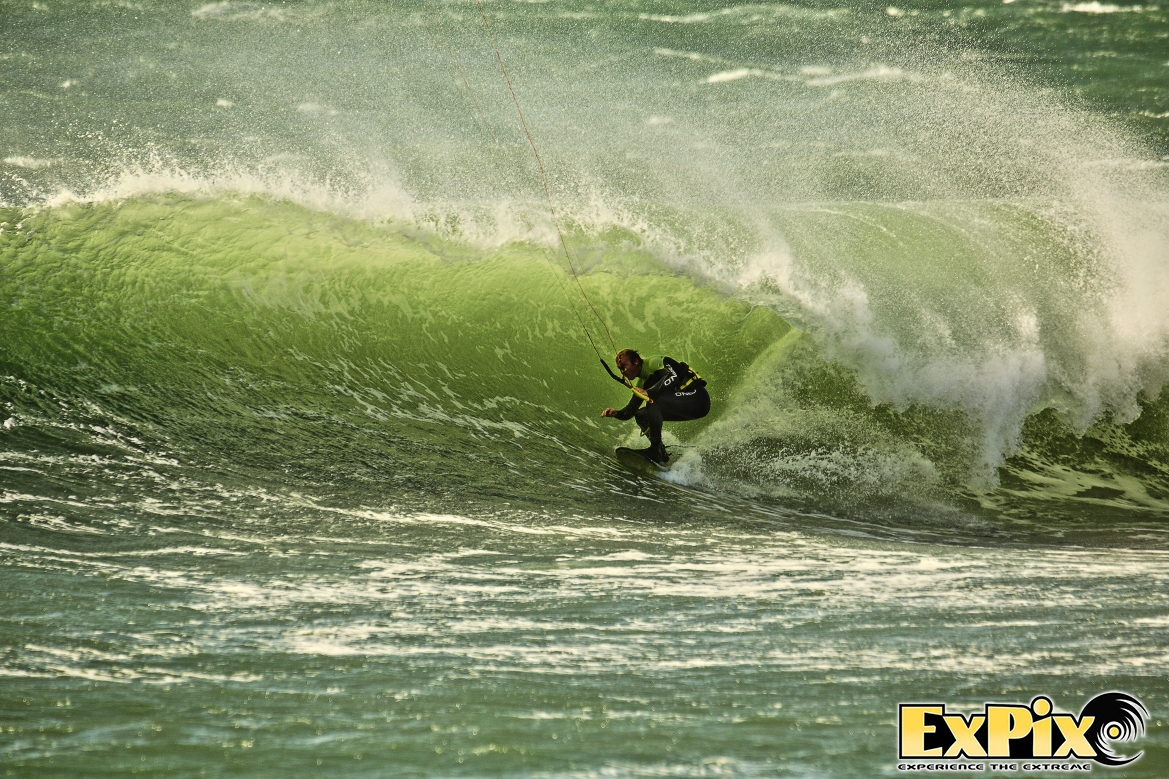 Lee 'Pasty' Harvey grabs a barrel at Porthleven